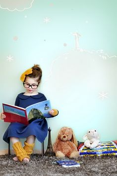 Adorable photo idea of a girl reading a book to her stuffed animals.