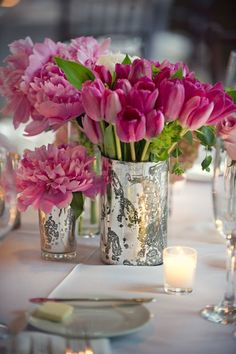 table decorations include tulips & peonies in mercury glass vases