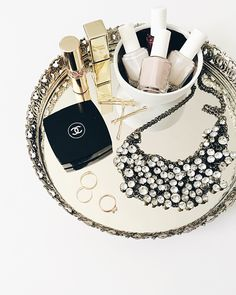 vintage mirrored tray with holiday jewelry and beauty picks