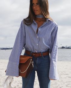 Make a button-down shirt and jeans outfit feel fashion forward with a neckerchief and bell sleeves