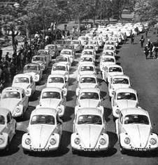 March 23, 1969, At Disneyland, 101 privately-owned Volkswagen Beetles parade down Main Street to celebrate Herbie Day (to promote The Love Bug film). The cars are judged in the categories of most psychedelic, toy-like, comical and best personality. Morton and Barbara Allen of Studio City, California, win the grand prize – a brand-new 1969 Volkswagen Beetle, presented by The Love Bug stars Dean Jones and Michele Lee.