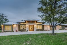 Rambler with a perfect media room Prairie Style House Plan - 5 Beds 4.00 Baths 4545 Sq/Ft Plan #935-13 Exterior - Front Elevation - Houseplans.com