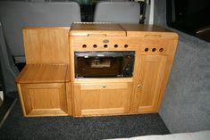 Just to prove ATT interiors fit as well in T5's as vintage vans, this furniture is made in oak and includes a bulkhead unit housing sink, hob, grill and portaloo. There is underbed storage accessed from both inside the van and from the rear doors.