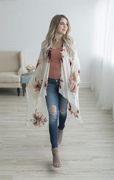​Nothing says spring like our Floral Kimono! This is this the perfect piece to add some class to your spring wardrobe!