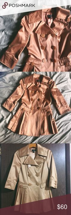 🎉HP🌟BEBE / copper jacket Bebe quarter sleeve jacket with buttons. The color is most similar to the first two photos - a coppery color. Lovely jacket with light sheen material. 60% cotton, 40% polyester. Pleated skirt adds a very flattering touch, like-new condition. bebe Jackets & Coats
