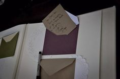 wedding guest book idea. Guests write comments on the tags and they get put in the envelope in an already made album.