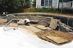Building a Stone Retaining Wall Fully settled subsoils, a well-compacted base of crushed stone, and good drainage are essential for long-lasting results