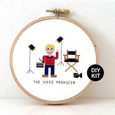 Cross Stitch Kit of video producer. Make your own video production gift. There's also a female video producer available! Designed by Studio-Koekoek #studiokoekoek #crossstitch