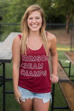 OU Crimson Cream Champs Piko tank top. This trendy tank top is sure to be a staple in your gameday wardrobe! Cheer on the University of Oklahoma Sooners in sty