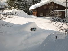 So much snow that you can hardly see the car