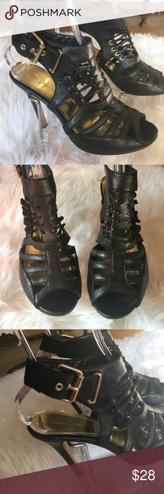 Vince Camuto Strappy Black Heeled Sandals. Preowned.  Great condition with some wear and scuffing on bottoms.  Heel height is 4 inches.  Front fixed laces and gold side adjustable buckles.  Price reflects. Vince Camuto Shoes Heels