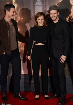 Three's no crowd! The actress cosied up to her handsome co-stars  Luke Evans (left) andDan Stevens (right)
