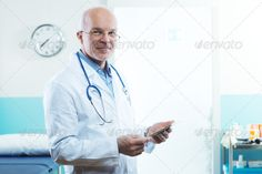 Doctor with tablet - Stock Photo - Images
