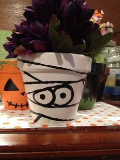 Items similar to Cute Mummy Painted Pot - Halloween on Etsy Halloween Clay, Halloween Flowers, Halloween Items, Halloween Crafts, Halloween Decorations, Flower Pot People, Clay Pot People, Clay Pot Projects, Clay Pot Crafts