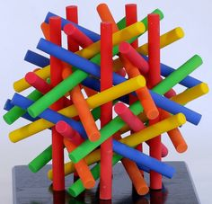 George W. Hart - Here are six sets of five parallel cylinders. Each set is orthogonal to a pair of dodecahedron faces.  This was a warm-up to the following one, which has twice as many rods.