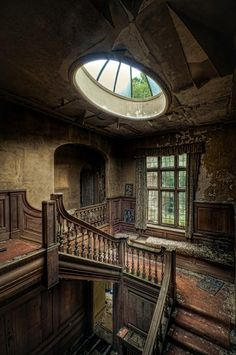 Derelict staircase with oval skylight.