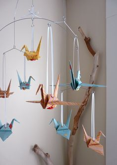 Origami Crane Mobile- My cousin gifted something very similar to this for Baby O's nursery :)