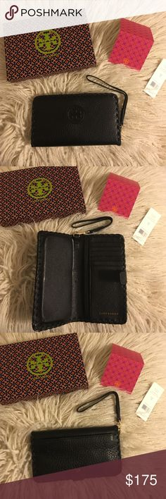 """Tory Burch Marion Smartphone Bi-fold Wristlet NWT Tory Burch Marion Smartphone Bifold Wristlet! It's the all-in-one for your mobile - it fits an iPhone 6 - and your cash and cards. Made of super-soft pebbled leather, it features plenty of pockets and compartments. Color is black! * Fold-over pin snap closure * Removable wriststrap * Fits an iPhone 5 and 6 * Length: 6.97""""  * Height: 3.98""""  No trades No lowballing ✅Bundle Discount  Authentic items  ✨purchase at listed price get a free gift✨…"""