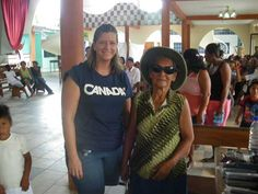One of our volunteers giving a woman new sunglasses and a hat! From our Peru, 2009 mission