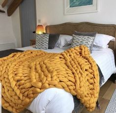 Sunset yellow ethically sourced  chunky knitted merino wool blanket by thechunkyneedle.com  #bedroom #interior #ochre #yellow #chunkyknit