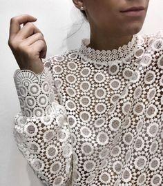 White lace blouse.
