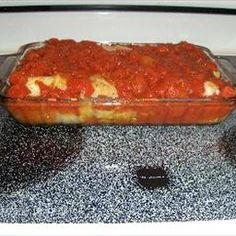 LAZY PIGS IN THE BLANKET CASSEROLE   3 c. chopped cabbage  1 lb. ground beef  1 med. onion  Salt and pepper  3 tbsp. uncooked rice  1 can tomato soup  1 can water  Brown ground beef and onion with salt and pepper. Add tomato soup, rice and water. Simmer 10 minutes. Pour over cabbage in a 2-quart casserole. Don't stir. Cover; bake covered at 325 degrees for 1 hour