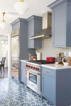 Blue Kitchen Cabinets Benjamin Moore Wolf Gray A Blue Grey Painted Kitchen Cabinets With Patterned Floor Tile And Gray Subway Tile Backsplash Interior Design By Ginny Macdonald Blue Gray Kitchen Cabinets, Grey Painted Kitchen, Farmhouse Kitchen Cabinets, Kitchen Cabinet Design, Painting Kitchen Cabinets, Kitchen Interior, Kitchen Decor, Kitchen Ideas, Kitchen Grey
