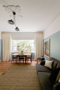 """Name: Joanne O'Callaghan Location: Melbourne, Australia Size: 510 square feet Years owned: 16 years Joanne recently renovated this late-1940s Art Deco apartment in East Melbourne, Australia. The entire place is full of light and charm, but the apartment's living and dining space, called the """"blue room,"""" is a particular jewel: It features Art Deco cornices, a tiered mirror above the original fireplace and a large framed window. Joanne writes: """"Our focus was to breathe life a..."""