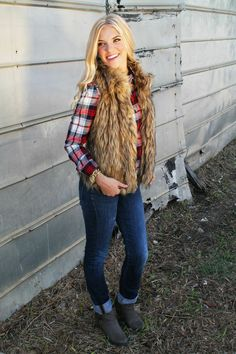 Adorable winter fur vest. Loving this outfit! http://www.sidelinesass.com/collections/outerwear/products/love-that-fur-vest