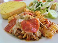 This Pizza Pasta Bake recipe is a family favorite. Flavorful pizza sauce tossed with rotini noodles, pizza toppings and melted cheese. YUM!