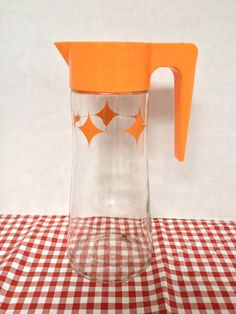 Retro vintage glass with orange diamond shape design juice pitcher tang by rummagechicboutique on Etsy