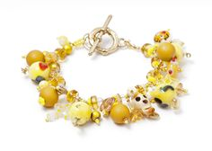 More yellow allsorts. Don't you love dangly bracelets? This one combines matte resin beads with shiny lampwork creations.