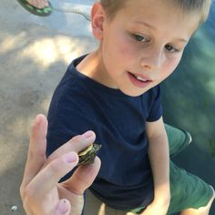 Baby turtles at the park and a scout, not mine but a new friend, with a gentle spirit and lightning fast lunge, with his prize catch and release creature. #activemoms
