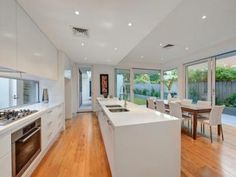Modern island kitchen design using floorboards - Kitchen Photo 1045529