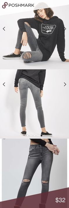 """Top Shop grey skinny ripped """"Jamie"""" 26 In a perennially cool high-waisted fit, the MOTO ankle-grazing Jamie is the original rock n roll skinny jeans that we fell in love with all those years ago. Crafted from a super-stretchy grey cotton blend for our signature soft denim feel, the iconic style includes multiple pockets, a top button fly and a ripped knee for an added edge. 92% Cotton, 6% Polyester, 2% Elastane. Machine wash. Topshop Jeans Skinny"""