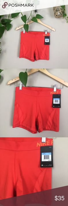Nike Pro Hypercool shorts Nike Pro Hypercool shorts. New with tags, size M. Bright red color with orange accents.  Tiny mark on back of shorts (pictured). New with tags so haven't washed, but really think mark would come off after washing! Color wasn't as flattering on me as I hoped🙄 Last pic depicts fit, not color.   👊🏼no trades ✨Thank you so much for shopping my closet! Shop around my other listings for one of a kind items.🦄 Nike Shorts