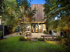 Architecture, Backyard Modern House Design With Garden And Outdoor Dining Room With Wooden Table Plus Bench Seat And BBQ Kitchen Ideas: The Lovely 27 Main Street Located in Northcote