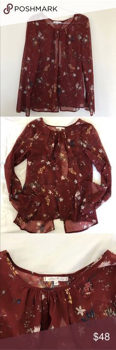 """Willow & Clay floral top Willow and clay burgundy floral sheer top with a unique twist back  Size M true to size   In pristine condition and perfect for spring!   Front 25"""" Back 26.25"""" Bust 21-21.5""""  No trades Willow & Clay Tops Blouses"""