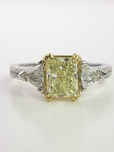 I just love this one... so so much. A yellow diamond is so elegant. Engagement Ring with Radiant Cut Yellow Diamond