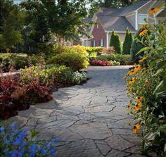 We love the way flowers line this Mega Arbel walkway.