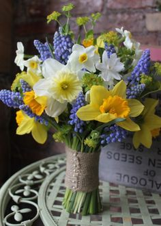 What a gorgeous Spring Bouquet - looks like something just picked from the spring time garden | Yellow and Blue Wedding flowers | Daffodil and grape hyacinth Wedding bouquet