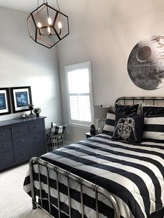 "Boys Star Wars Room. Boys Star Wars bedroom. Modern design for boys bedroom. Star Wars. ""I wanted to create a fun space for my 8 year old with a Star Wars themed room. He has loved all things Star Wars since he first saw the movies. Yet, I also wanted the flexibility to change out the theme of the room when he grows out it."" #Boysbedroom #bedroom #StarWars mytexashouse"