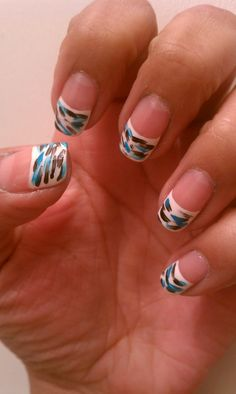 White French Tip nails with paint brush strokes of black and teal
