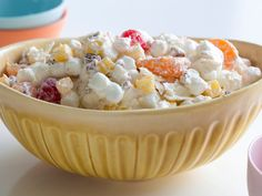 Get the Ambrosia Salad Recipe by Alton Brown of Food Network from Best Recipes. Desserts Ostern, Köstliche Desserts, Delicious Desserts, Dessert Recipes, Yummy Food, Sweet Desserts, Fruit Recipes, Dinner Recipes, Appetizer Recipes