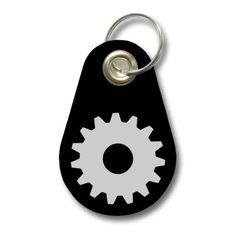 Schlüsselanhänger Zahnrad. Filz Schlüsselanhänger mit Zahnrad Aufdruck