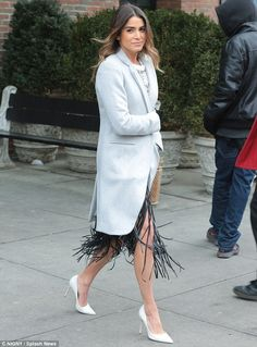 Legs on show:Nikki Reed called attention to her spectacular legs wearing a black fringe s...