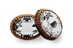 Elegant and striking Swarovski Crystal, white-coloured, in artistic setting of bronze.  http://mysfashion.com