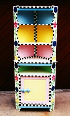 corner cabinet ......... I pinned this one because it's so unique, so many great colors and very talented.