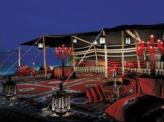 "FOUR SEASONS HOTEL DOHA Doha, Qatar  This Moorish-designed hotel showcases local white stone, latticework domes, geometric patterns, arches, columns, and palms galore, and presents ""beautiful lobby floral arrangements."""