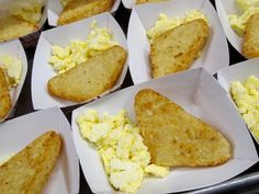 Scrambled eggs and hash browns are plated and ready to be served to students in Provo School District, UT.
